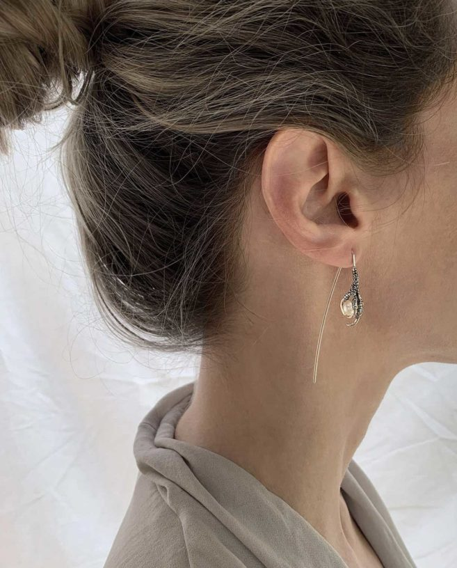 bird claw and pearl earrings